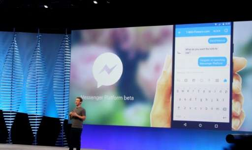 """Facebook chief and co-founder Mark Zuckerberg show developers at a 2016 conference how """"bots"""" can respond to natural l"""