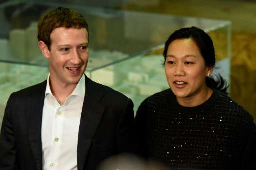 Facebook founder and CEO Mark Zuckerberg (L) and his wife Priscilla Chan pledged $3 billion over the next decade to help banish