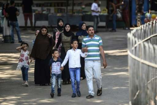 Families enjoy a day out at the Egyptian capital's Giza Zoo