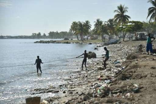 Fishermen pull a net while fishing in Cap-Haitien, Haiti, where few have prepared for massive Hurricane Irma