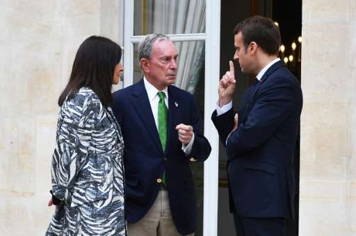 Former New York mayor, Michael Bloomberg, seen here meeting with French President Emmanuel Macron and Paris mayor Anne Hidalgo,