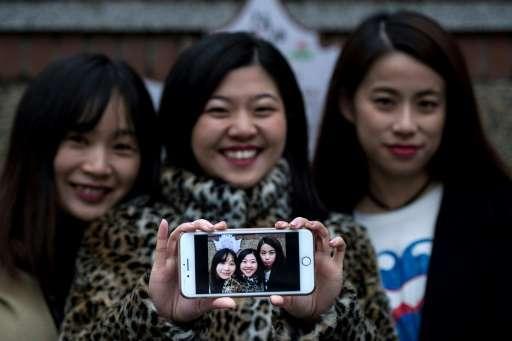 (From L) Hu Dongyuan, Wang Peng and Peng Lin display their selfie in Shanghai