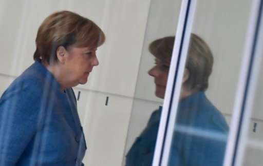 """Germany's Angela Merkel has been dubbed """"climate chancellor"""" but critics say she tends to cave in when it matters"""