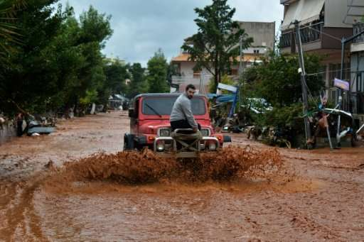 Greece's civil protection authority said heavy rainfall was complicating search and rescue efforts in Mandra, Nea Peramos and Me