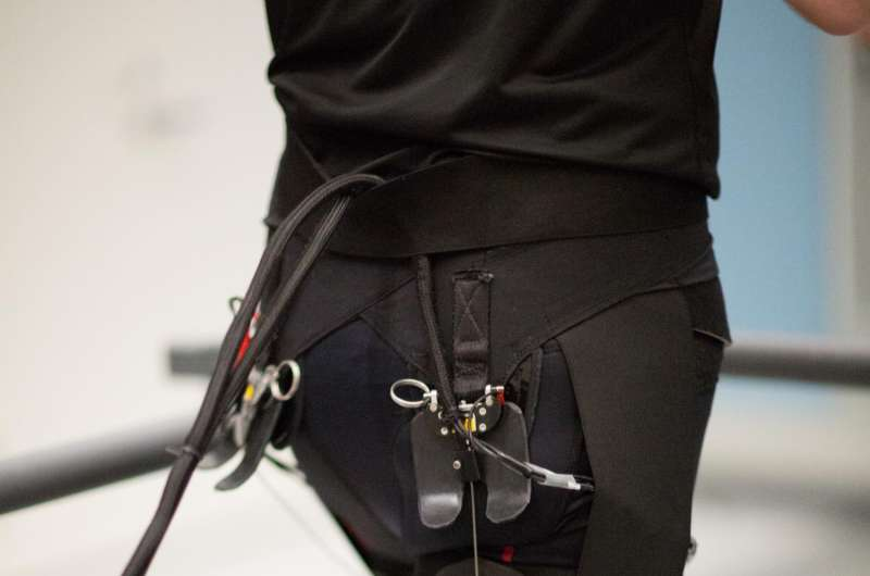 'Harder, better, faster, stronger'-tethered soft exosuit reduces metabolic cost of running