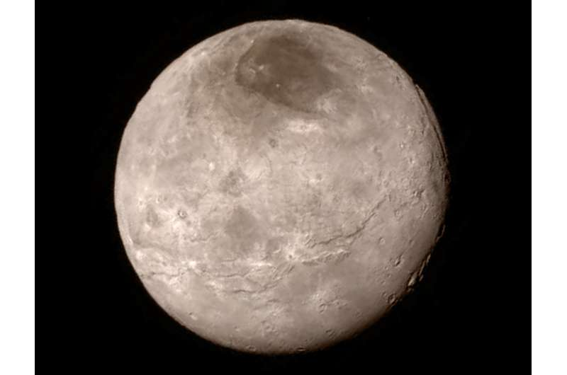 How a moon slows the decay of Pluto's atmosphere
