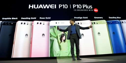 Huawei's CEO Richard Yu presents the new phone Huawei's P10 during a press conference on February 26, 2017 in Barcelona on the e