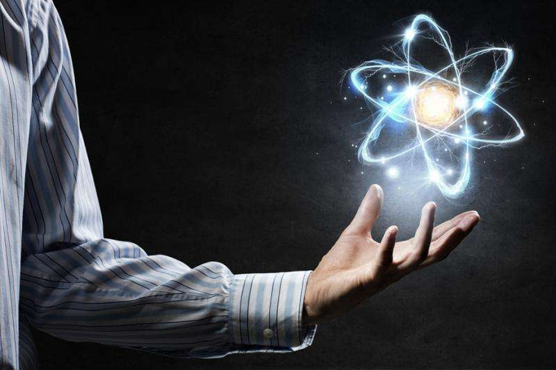 If atoms are mostly empty space, why do objects look and feel solid?