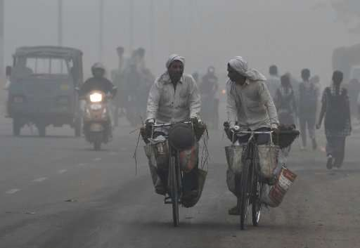 Indian commuters struggle through heavy pollution in New Delhi, which has been under a choking blanket of smog, with air quality