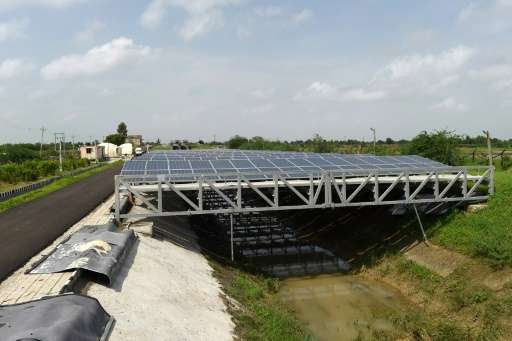 India, the world's third-largest polluter, is banking on solar projects like these canal-top solar panels in Chandrasan village,