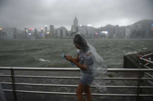 More than 120 were injured in Hong Kong as the territory was lashed with hurricane winds and pounding rain