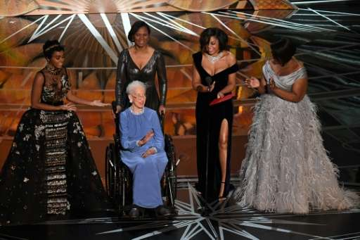 NASA physicist Katherine Johnson (C), whose likeness is set to be made into a Lego, is surrounded by Hidden Figures actresses Ja