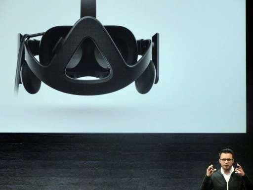Oculus chief executive Brendan Iribe unveils Rift virtual reality head gear, in San Francisco, in 2015