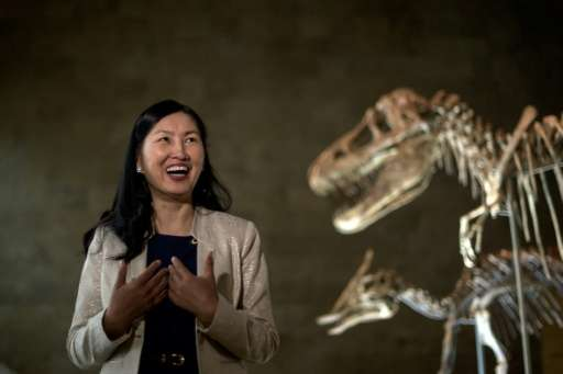 Oyungerel Tsedevdamba, Mongolia's former minister of culture, sport and tourism in front of the Tyrannosaurus Bataar in a museum