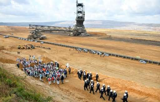 Police prevent environmentalists from continuing their march during a protest at an open pit mine in western Germany
