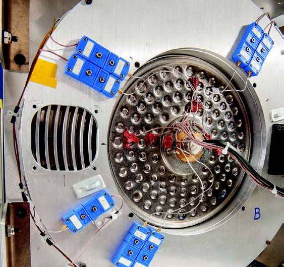Radial core heat spreader to improve Stirling radioisotope generator heat rejection