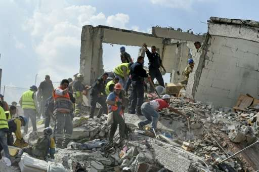 Rescuers hunted for survivors amid the rubble of a collapsed building after a powerful quake struck Mexico City on Tuesday