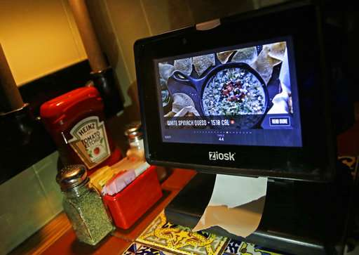 Restaurants use technology to nudge us into spending more