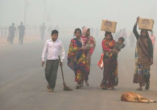 Rickshaw drivers, street vendors and tens of thousands of homeless families endure the full force of pollution that doctors warn