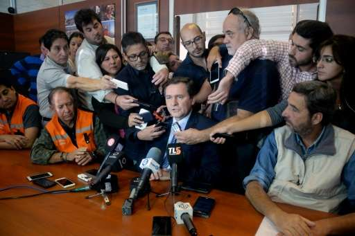 San Juan's province Mining Minister Alberto Hensel (C) speaking during a press conference in San Juan, west of Argentina on Marc