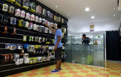 Shopping at a store in Libya's second city Benghazi where customers can use a mobile phone app to pay for their purchases electr