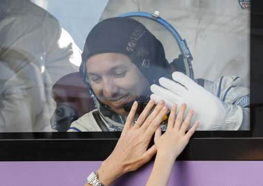 Space capsule with 3 astronauts blasts off to orbiting lab