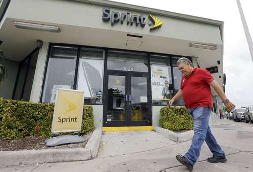 Sprint posts rare profit, says a deal may be coming soon