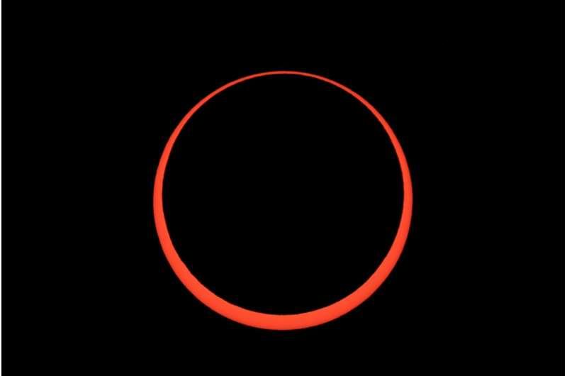Stargazers applaud as moon eclipses sun
