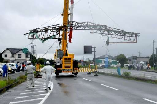 Storm damage in the city of Kumamoto on Kyushu island, where Typhoon Nanmadol made landfall packing winds of up to 144 kph (89 m