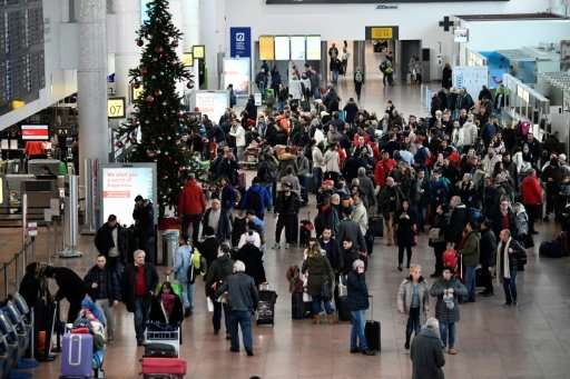 Stranded travellers at Brussels Airport on Monday