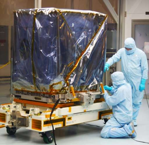 Technicians prepare the Neutron Star Interior Composition Explorer payload in April 2017 ahead of its delivery to the Internatio