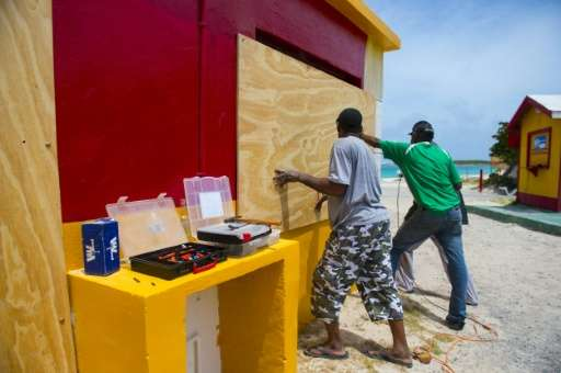 The Caribbean region was hunkering down as monster Hurricane Irma slammed into Barbuda as a rare Category Five storm early Wedne