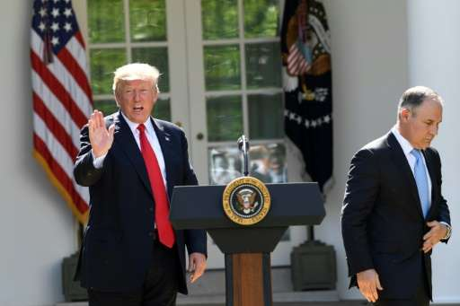 The head of the Environmental Protection Agency Scott Pruitt (R) and US President Donald Trump speak to the media in the Rose Ga