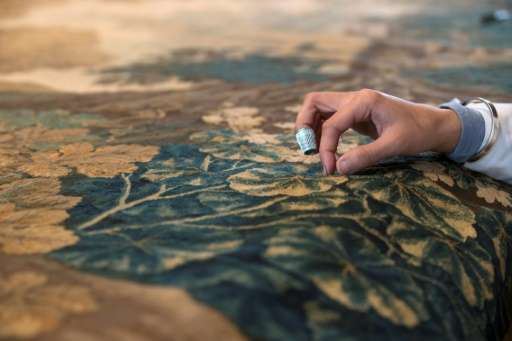 The painstaking work of restoring an old tapestry can take more than a year