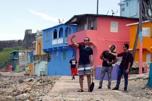 """The poor La Perla neighbourhood of San Juan, where the """"Despacito"""" video was recorded, has seen a boom in tourists who"""