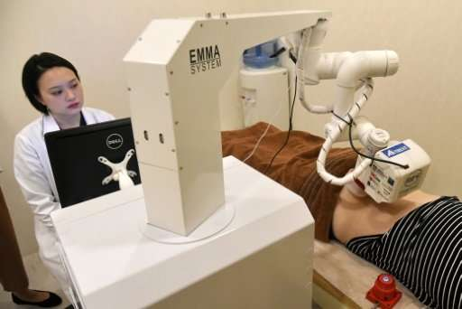 "The robot named Emma is the brainchild of local startup AiTreat and performs ""tui na"", a type of massage practised in"