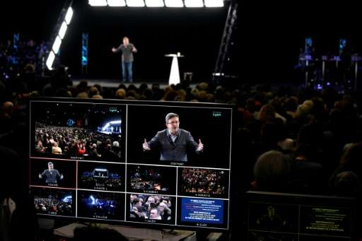 The screen broadcasting the speech of French presidential election candidate for the far-left coalition Jean-Luc Melenchon is pi