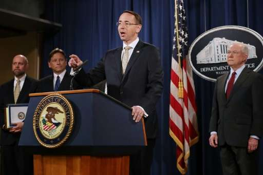 The shutdown of two dark web marketplaces announced by US Deputy Attorney General Rod Rosenstein (C), Attorney General Jeff Sess