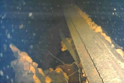 This handout video grab taken with an underwater robot and provided by Japan's International Research Institute for Nuclear Deco