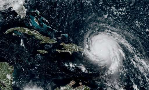 This satellite image obtained from the National Oceanic and Atmospheric Administration (NOAA) shows Hurricane Irma at 1800UTC on