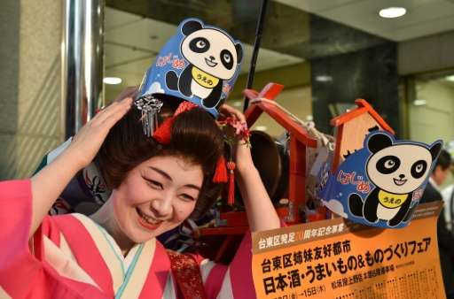 Tokyo has gone panda crazy since the birth Monday of a tiny cub to Shin Shin and Ri Ri at Ueno Zoo, with department store staff