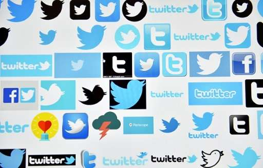 Twitter reports sluggish revenue and user growth, with widening losses in the past quarter