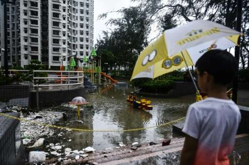 Typhoon Hato brought floodwaters and debris to large parts of Hong Kong