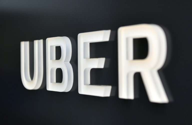 A French court ruled that drivers for Uber could not be considered employees, saying the ride-hailing giant was acting only as a