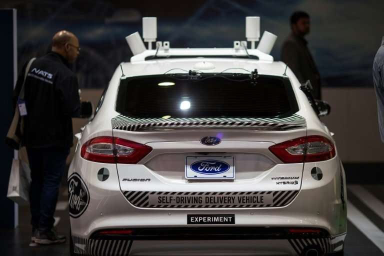An experimental Ford Fusion self-driving delivery car displayed in Las Vegas