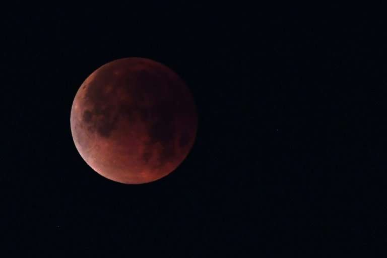 """A """"blood moon"""" seen in January: On Friday, the longest such eclipse this century can be seen in the sky near Mars, whi"""