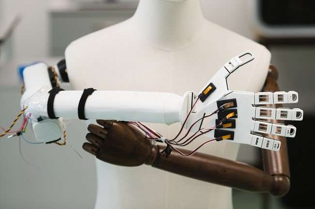 A robotic hand covered in 'brainy skin' that mimics the human sense of touch is being developed by scientists.