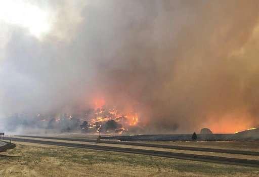 California fire kills 1 as heat stokes blazes in Western US