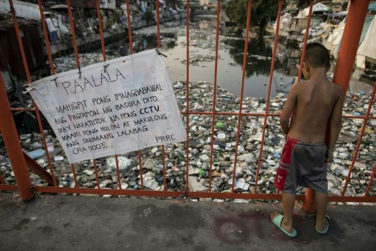 City officials blame the  residents of the Manila slum for using the creek as an open-air dump