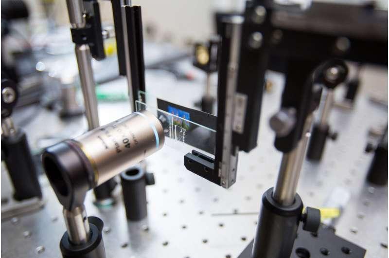 Hybrid optics bring color imaging using ultrathin metalenses into focus